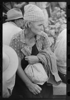 1938. Day laborer employed in cotton picking Lake Dick Project, Arkansas.