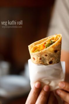 veg kathi rolls recipe - delicious wraps or rolls stuffed with a spiced mix veg stuffing.