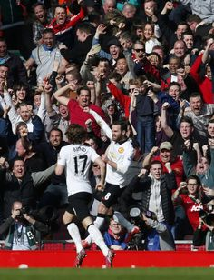 Daley Blind and Juan Mata celebrating United's goal against Liverpool [22/03/2015]