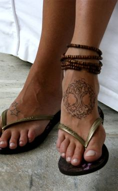 Celtic Tree of Life tattoo on top of foot ...love it. I hate the stars on the other foot though..