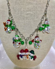 Snowmen Christmas Winter White Green Red Vintage Silver Chain Assemblage Upcycled Necklace Doodaba by doodaba on Etsy Christmas Necklace, Holiday Jewelry, Vintage Holiday, Christmas Snowman, Winter White, Snowmen, Vintage Silver, Repurposed, Chain