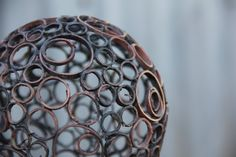 Reclaimed copper pipe made in to a copper sphere - this would look outstanding in my garden | $95.00, via Etsy. http://www.etsy.com/listing/123265042/small-mixed-copper-ring-ball-copper