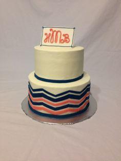 Chevron patterned baby shower cake.
