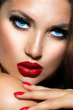 Red lips with stunning red lipstick and matching nail colour