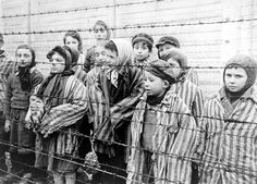 "Child survivors in Auschwitz shortly after liberation by the Red Army. They belonged to Dr. Mengele's group of human guinea pigs for ""research"" into the genetic profiles of twins -- a subject dear to the mass murderer known as the White Angel."