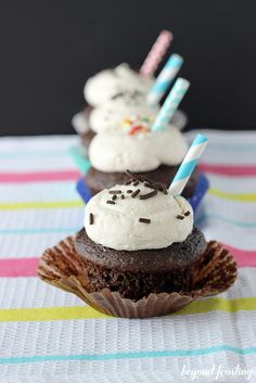 Rootbeer Float Cupcakes with Whipped Vanilla Frosting by Beyond Frosting. Ingredients: chocolate cake mix, eggs, milk, veg oil, sour cream, vanilla, root beer concentrate.  Frosting:  butter, powdered sugar, vanilla, heavy whipping cream