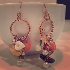 Seashells earrings A combination of different seashells as part of your earring design. Beautiful for casual wear! Accessories