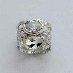 Sterling silver band with a single clear zircon gemstone, April birthstone - Endless night. on Etsy, $79.00
