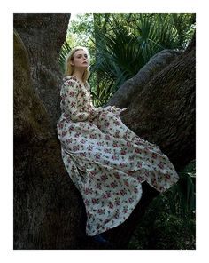 Elle Fanning in a custom Gucci Pre-Fall 2017 gown with ruffle details by Alessandro Michele featured in Vogue Magazine's June issue.