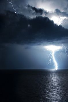 Huge Lightning bolt over the ocean on a dark stormy night.