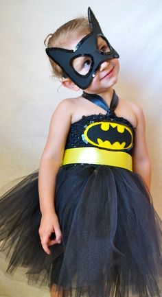 Batgirl costume inspiration. Maybe do black and hot pink instead?