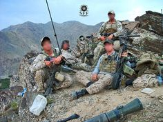 CARL GUSTAV. SEAL Team with CG lying on the ground in foreground. jdm
