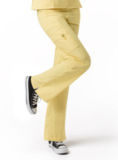 The Romeo 5026 - WonderWink 6-pocket, Flare leg pant with 50/50 drawstring/elastic waist. Available at Scrubs & More, The Uniform Store in the following colors:  Black, Ceil Blue, Green Apple, Hot Pink, Navy, Orange Sherbet, Pewter, White & Yellow (shown in image).  Sizes Reg. XXS - 2XL.  *Also available in Petite sizes XSP - 2XP in Black, Ceil, Navy, Royal & White.  Perfect to match with Wink top styles: Bravo 6016, Charlie 6026, or Golf 6056.