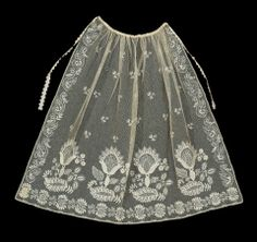 "1820-40 Apron, cotton net with cotton embroidery and silk ribbon. (26 3/8"" x 31 1/2""). MFA 28.832"