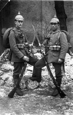 Two riflemen of a WW1 Guards Battalion of the Prussian Army pose for a photographic memento with their Mauser 98 rifles and full kit. The 98 is still in use for ceremonial duty with some units of the present-day German army.