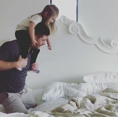 Jensen playing with his daughter, JJ.
