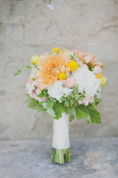 white orange and yellow bridal bouquet #bouquet #weddingflowers #weddingchicks http://www.weddingchicks.com/2014/03/12/santa-barbara-yellow-and-gray-wedding/