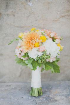 white orange and yellow bridal bouquet #bouquet #weddingflowers #weddingchicks http://www.weddingchicks.com/2014/03/12/santa-barbara-yellow-and-gray-wedding/