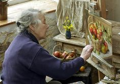 Anne cotterill painting in her studio