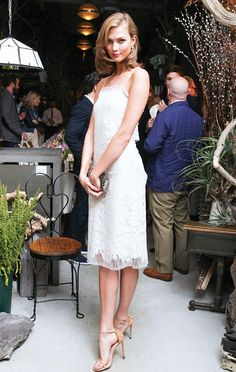 Karlie Kloss wearing summer's chicest #musthave sandals by Stuart Weitzman.