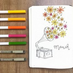 Bullet journal monthly cover page, March cover page, flowers coming out of a gramophone drawing. | @bullet.rookie