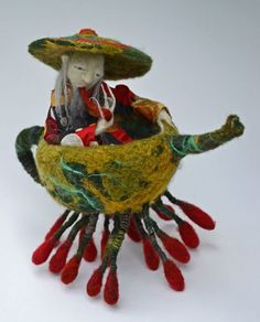 I work with two artist groups which inspire me daily, TAFA: The Textile and Fiber Art List and Artizan Made. Both have amazing talent and I love seeing what they come up with! Several have made teapots that need to be seen. Some are functional, but others would just melt if you added hot water.