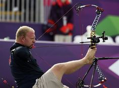 Matt Stutzman of the U.S. uses his feet to support his bow and his teeth to fire the arrow during the Archery Men's Individual Compound - Open at the London 2012 Paralympic Games, Aug. 31. (Photo: Olivia Harris / Reuters)