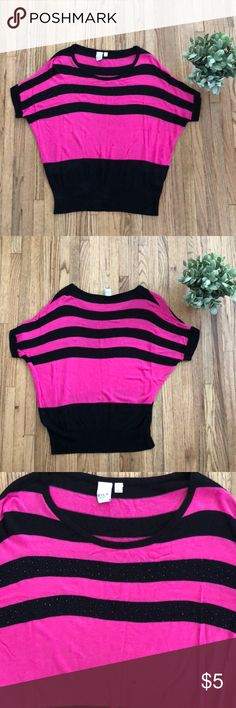 Cute Top Cute pink and black top. There is a small spot on the front as seen in the photo and comes from a smoke free home. It says size XL, but it's definitely not. I'd say it would fit a Small/Medium. VILA Tops