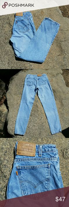 """Rare orange tab 550 Levi jeans Another great pair of rare 70s orange tab 550 Levi jeans! These are a lighter wash so you can take two pairs home if you want! 550s always have a nice high waist and tapered leg, marked a 31x34 as well but run smaller. Waist measures 15"""" across, hips approx 20.5"""" rise is 11.5"""" inseam is 31.5"""". Great of you have longer legs! Fits like a 29 or 30 Levi's Jeans"""