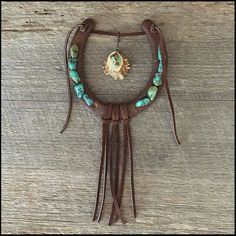 "http://OzarkMountainRustic.com This decorated horseshoe makes a great gift for anyone who loves horses, western home decor or anything with a southwest vibe. Besides having a good luck horseshoe hanging above the doorway to a favorite room OR hanging anywhere in the house, it will certainly be a conversation piece. The rustic horseshoe is kept natural and features natural turqoise, a deer antler ""button"", and rawhide hanger and tassel."