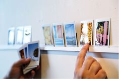 """Here's an easy project to decorate the walls with your collection of photos for under $20. Print out those Instagrasms or Flickr photos as 3 1/2"""" x 4"""" images and use a Polaroid photo template for the full effect"""