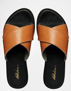 http://us.asos.com/Park-Lane-Tan-Leather-Cross-Strap-Slide-Sandals/15gkjt/?iid=4572243&cid=1931&Rf989=5025&Rf-800=-1,54&sh=0&pge=0&pgesize=204&sort=-1&clr=Tan&totalstyles=189&gridsize=3&mporgp=L1BhcmstTGFuZS9QYXJrLUxhbmUtVGFuLUxlYXRoZXItQ3Jvc3MtU3RyYXAtU2xpZGUtU2FuZGFscy9Qcm9kLw..