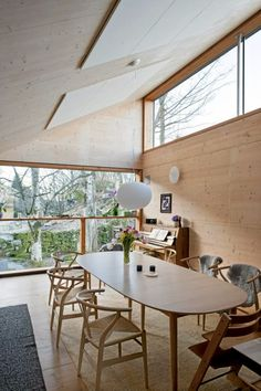 a bright, airy Danish modern dining room in natural wood