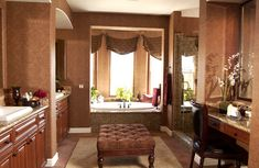 Masculine bathroom and dressing room in brown with separate soaker tub nook
