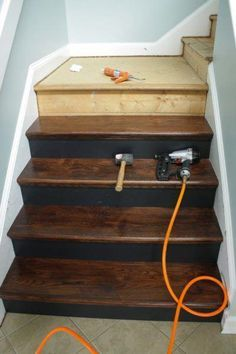 Home Remodeling Ideas - Removing carpet from stairs and replacing it with wood stair treads is totally doable. This DIY staircase makeover was accomplished in a weekend and looks like a professional job! Proof that a staircase remodel can be a DIY job. Home Remodeling Diy, Basement Remodeling, Home Renovation, Bathroom Remodeling, Basement Remodel Diy, Kitchen Remodel, Wood Stair Treads, Wood Stairs, Basement Stairs