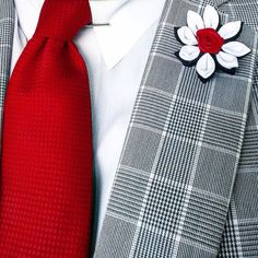 Stylish lapel flower that you just cant pass on. The colors shown are black, white with a red rose center. This is one that will fit any occasion and attire. Custom colors are available upon request. Yours today and ready to ship