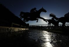 Runners clear the frozen water jump in The Betfred Mandarin Handicap Steeple Chase at Newbury racecourse on December 29, 2014 in Newbury, England. (December 28, 2014 - Source: Alan Crowhurst/Getty Images Europe)