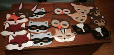 felt woodland animal masks. Make for the kids to wear. Maybe hang them from a branch in a vase