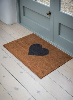This generously sized doormat shows your guests some love as they enter your home