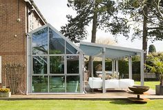 large glass veranda intetegrated with lean to extension