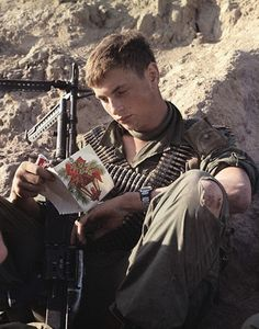 13 Dec 1967, Bear Cat, South Vietnam. PFC Wayne Baldwin (Groveland, Mass.), machine gunner, 4th Bn., 39th Inf, 1st Bde, 9th Inf Div, reads a Christmas card from home after mail call at Bear Cat, approximately 25 km. northeast of Saigon. Image by © Bettmann/CORBIS