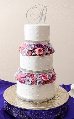 Lavender, lilac and pink roses make this wedding cake a pastel lover's heaven