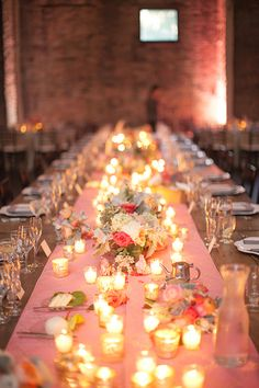 Farm tables with pink runners and garden roses are perfect for a late-summer wedding | @lauraivanova | Brides.com