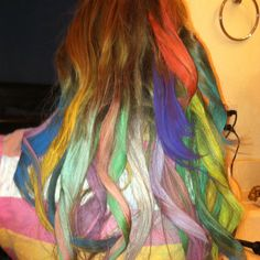 Coloring hair with pastel chalk.  This is my 10 year old daughters hair after we colored it with pastel chalk we got at Micheals.  The process was easy.  Just section damp to wet hair pick your chalk color and rub on hair with downward motions.  Going up and down tangled hair.  When done blow dry or flat iron to dry hair.  This is a messy process so I suggest wearing gloves and old clothing.  Chalk will wash out the next day!