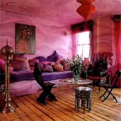 Those amazing wide slat wood floors balance the super exotic purple sofa and lush pink things all over the place. The walls are pretty cool too. Bohemian Interior, Bohemian Decor, Bohemian Living, Bohemian Style, Indian Room, Purple Sofa, Purple Velvet, Interior Decorating, Interior Design