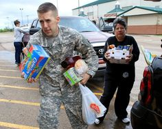 CW2 Joshua Johnston from Ft. Hood helps collect donated items at the Extraco Events Center for the victims in the West explosion. Canned goods, clothing and toiletries can be dropped off Friday from 9-6 a blood drive from 1-6 will also take place.