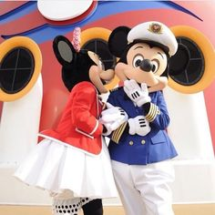 Minnie gives kisses to Mickey on board a Disney Cruise Line ship.