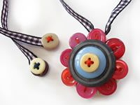 button jewellery sewed onto fabric and ribbon