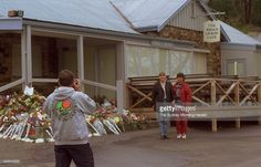 Mourners take a picture outside the Broad Arrow cafe at the Port Arthur historic site in the days after the Port Arthur massacre, when a lone gunman shot and killed 35 people at the site, 5 May 1996. SMH Picture by DALLAS KILPONEN