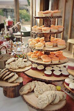Rustic wooden wedding cupcake display #wedding #cupcakes #cupcaketower #wood #desserttable